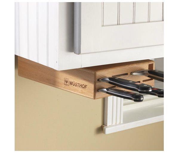Хранение ножей в ножнах, аккуратно установленных под шкафчиком