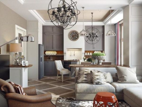В загородном доме прихожая, комната для гостей, кухня объединены в одно просторное помещение