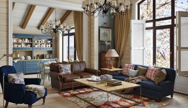 Мягкие диваны, плетеные кресла, комоды в комнате – все это характерные признаки стиля кантри