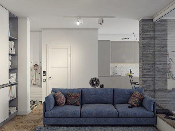 Синий диван в окружении серого интерьера разных оттенков