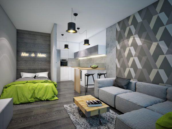 Уютная спальная комната с зелеными аксессуарами в сером интерьере
