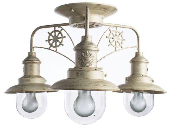 Элементы на люстре, по форме напоминающие судовой влагозащищенный фонарь